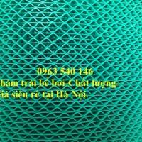 Thảm trải bể bơi nhựa lưới màu xanh lá.